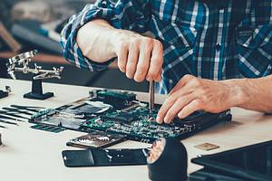 Asset disposition employee working on hardware
