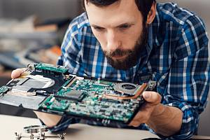Employee completing degaussing services on a hard drive