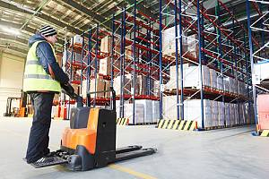 Destruction specialist on fork lift in warehouse