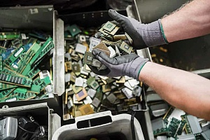 recycling worker dealing with electronics parts for ITAR compliant recycling
