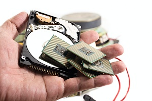 hand holding small electronics parts