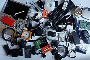 old electronics gathered together on the ground to be recycled