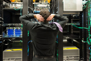 employee examine the structure of equipment before unplugging and sending them to a electronic data destruction business